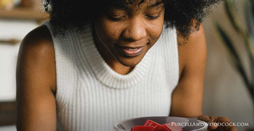 Woman Smelling Fragrance