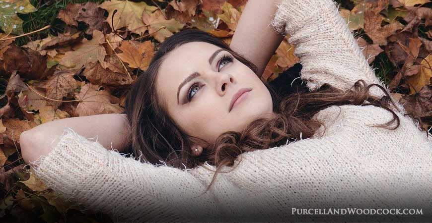 Woman Laying on Leaves